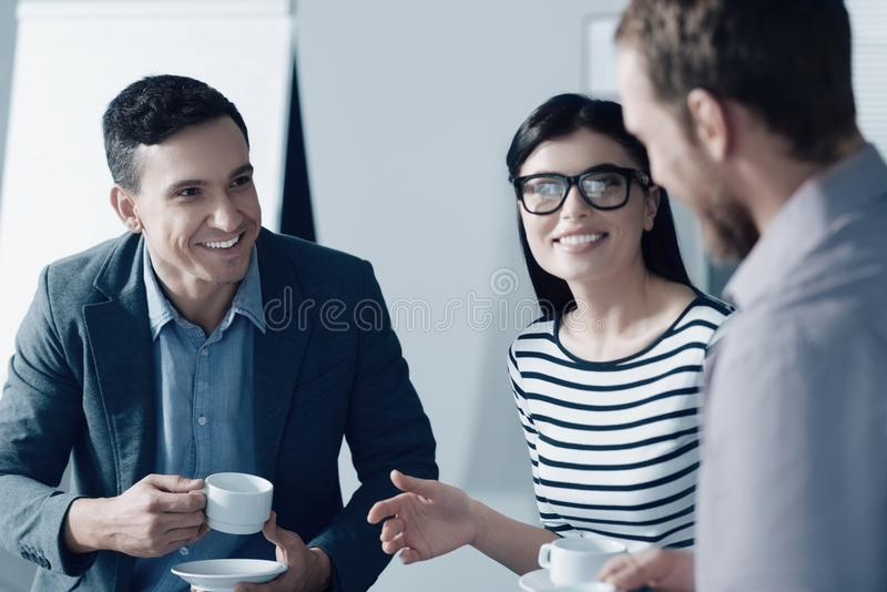 Cheerful young businesspeople having a break in the office stock image