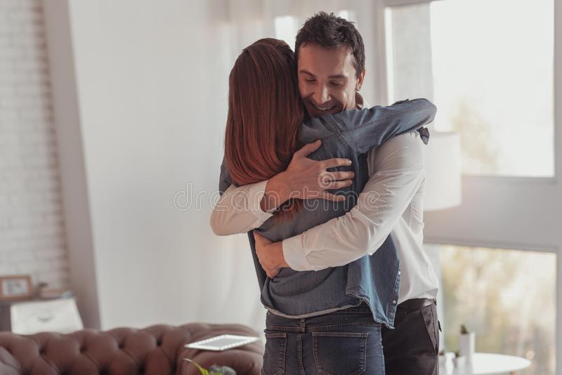 Cheerful young couple being lost in embraces royalty free stock photography