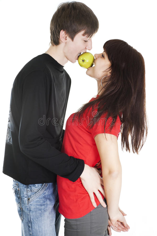 Download Cheerful Young Couple Eats One Apple Stock Photo - Image of beauty, eating: 18204086