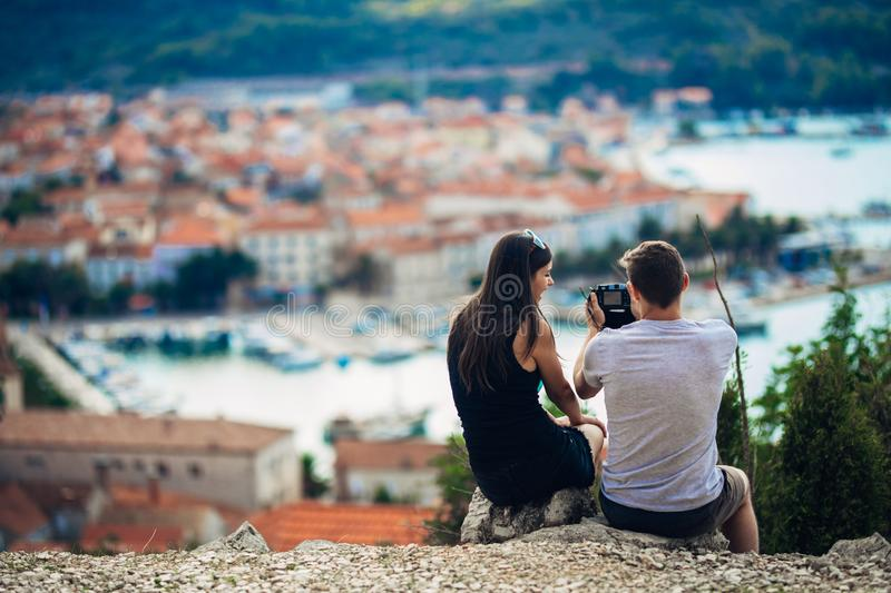 Cheerful young couple having a field trip date.Cityscape sightseeing,seaside travel vacation.Traveling in Europe royalty free stock photo