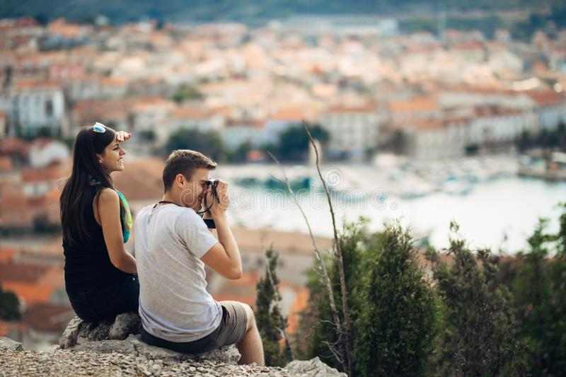 Cheerful young couple having a field trip date.Cityscape sightseeing,seaside travel vacation.Traveling in Europe stock photo