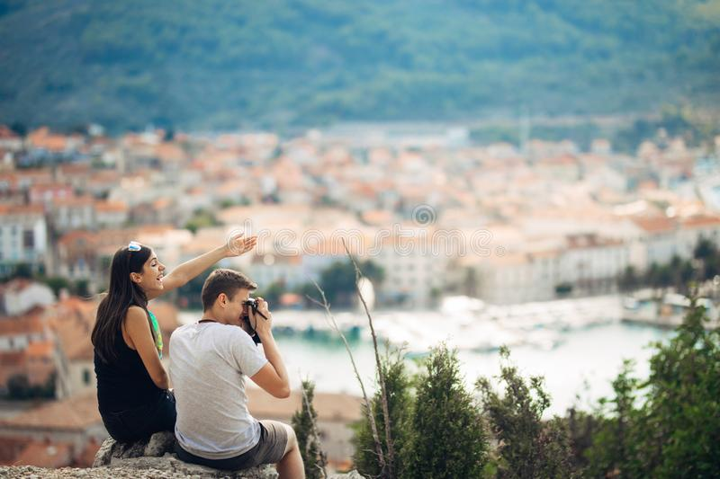 Cheerful young couple having a field trip date.Cityscape sightseeing,seaside travel vacation.Traveling in Europe stock photos