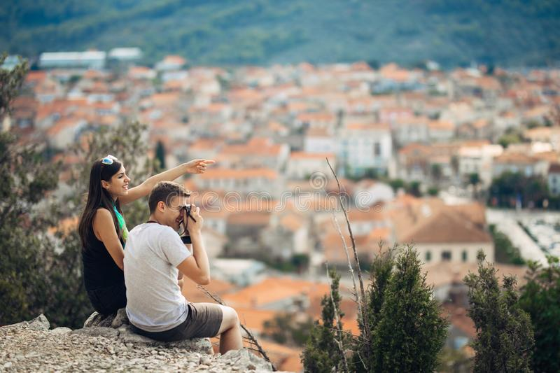 Cheerful young couple having a field trip date.Cityscape sightseeing,seaside travel vacation.Traveling in Europe royalty free stock photos