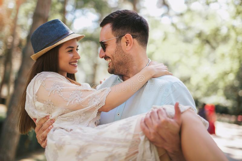 Cheerful young couple having fun and laughing together royalty free stock photo