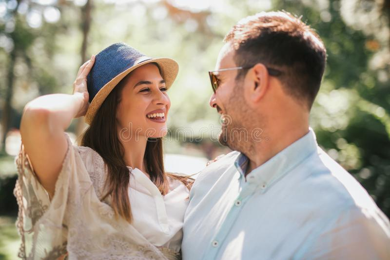 Cheerful young couple having fun and laughing together stock image
