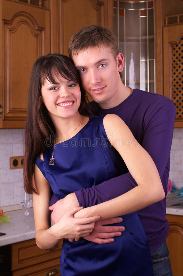 Cheerful young couple at home stock images