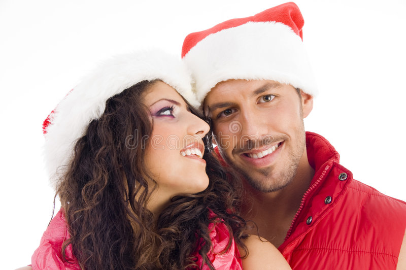 Download Cheerful Young Couple Wearing Christmas Hat Stock Photo - Image: 7360966