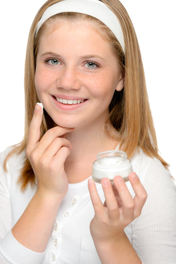 Download Cheerful Young Girl Applying Moistuizer Face Cream Stock Image - Image: 30337101
