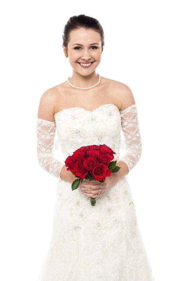 Cheerful young girl in bright bridal dress stock photos