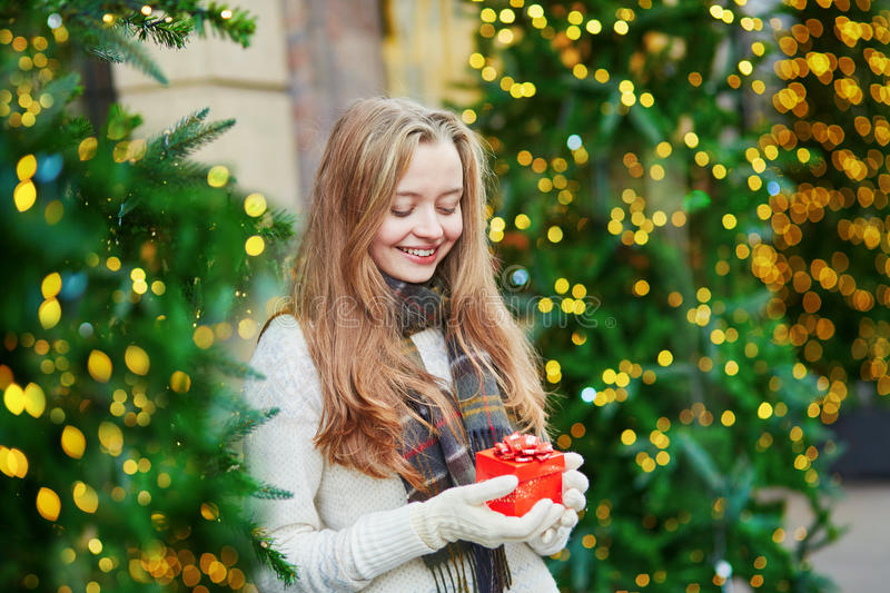 Cheerful young girl with little present box royalty free stock image