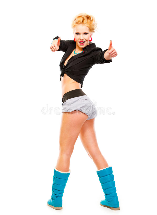 Cheerful young girl showing thumbs up gesture. Full length portrait of cheerful young girl standing in half-turn showing thumbs up gesture isolated on white stock photos