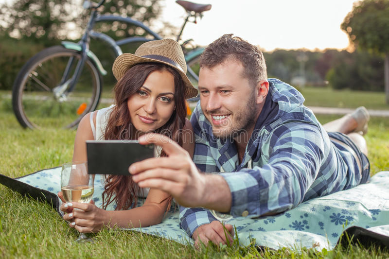 Cheerful young loving couple is dating in the stock photography