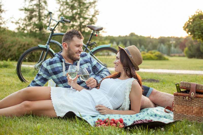 Cheerful young loving couple is dating in the stock photos