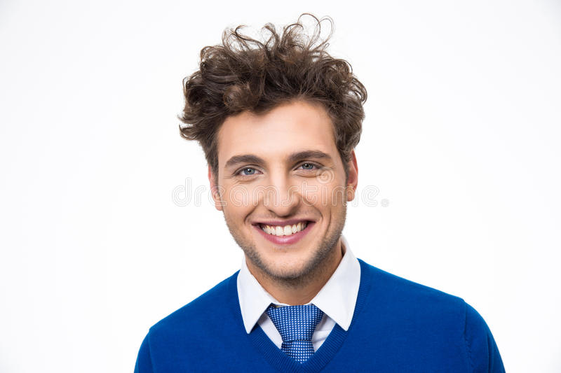 Cheerful young man. Over gray background royalty free stock photography