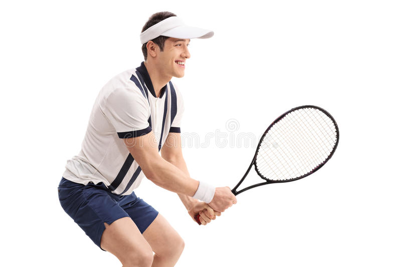 Cheerful young man playing tennis stock photography