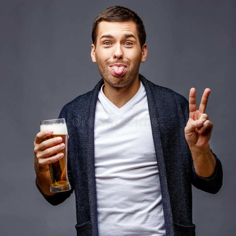 Cheerful young man in smart casual wear stock image