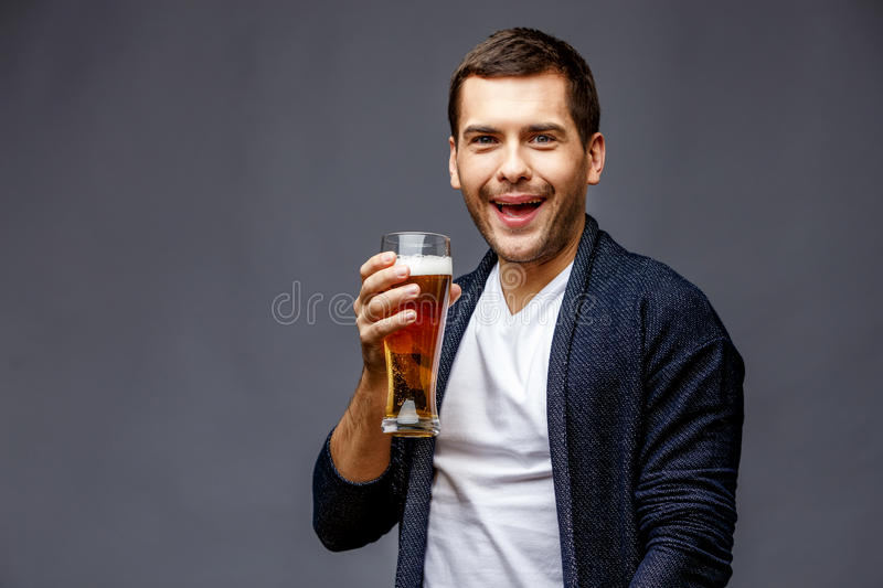 Cheerful young man in smart casual wear royalty free stock photo