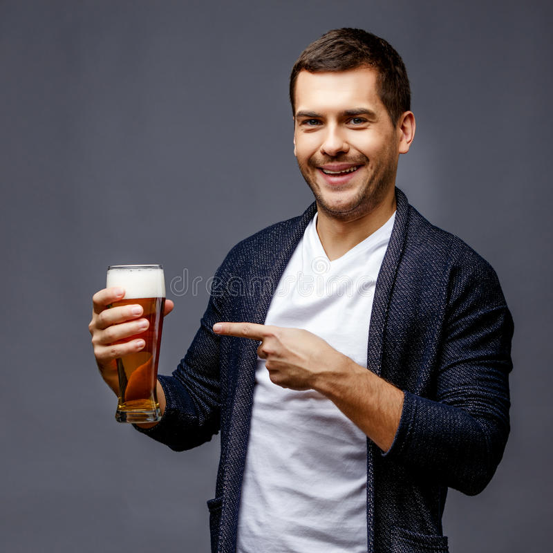 Cheerful young man in smart casual wear stock photo