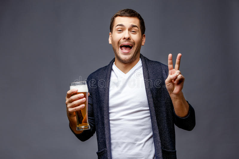 Cheerful young man in smart casual wear royalty free stock image