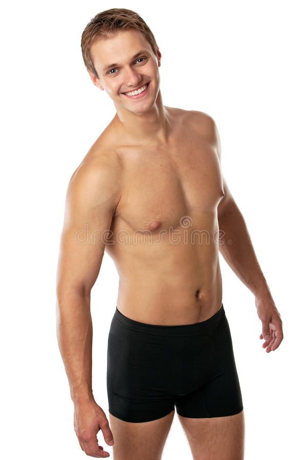 Cheerful Young Man In Trunks Royalty Free Stock Images