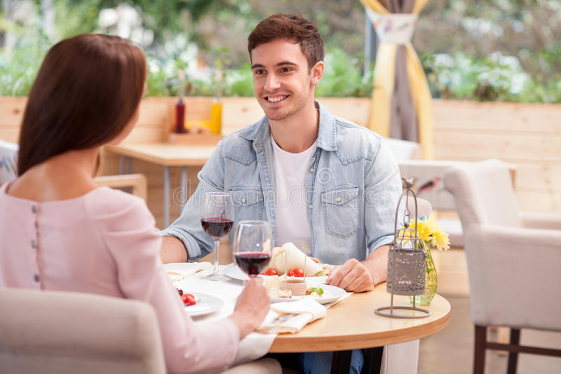 Cheerful young man and woman are resting in stock photos