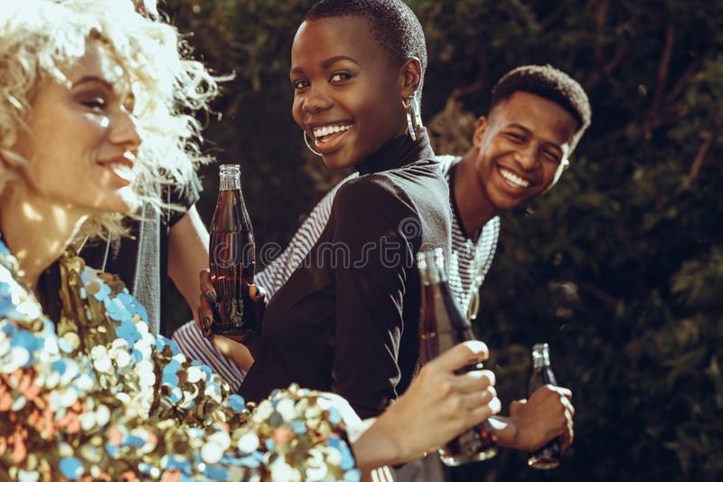Multi-ethnic friends hanging out in the city royalty free stock images