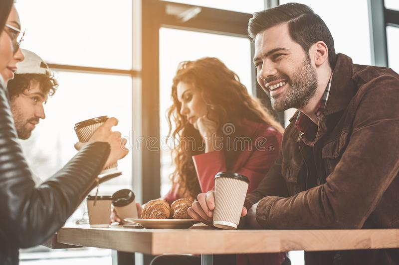 Outgoing young people having fun in cafeteria royalty free stock image