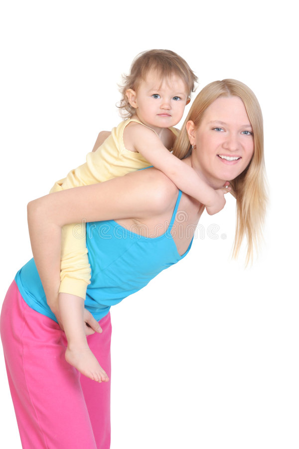 Cheerful young mother and her baby stock photos
