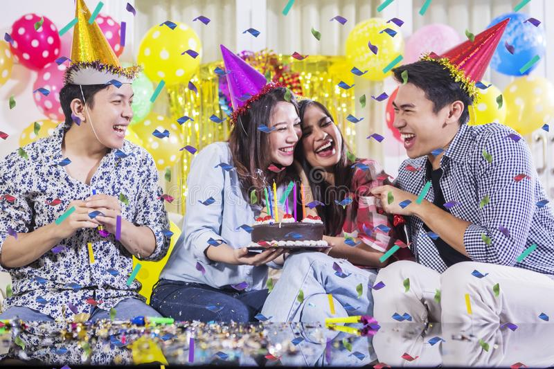 Cheerful young people celebrate a birthday party stock photo