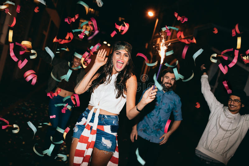 Cheerful young people having a party royalty free stock image