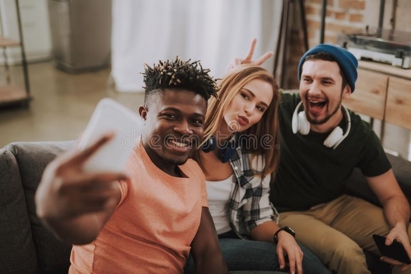 Cheerful young people making selfie while spending time at home stock photos