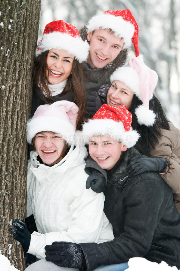 Download Cheerful Young People In Rad Hats Stock Image - Image of christmas, outdoors: 17395637