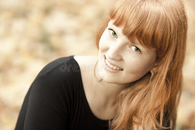Cheerful young red haired girl stock image