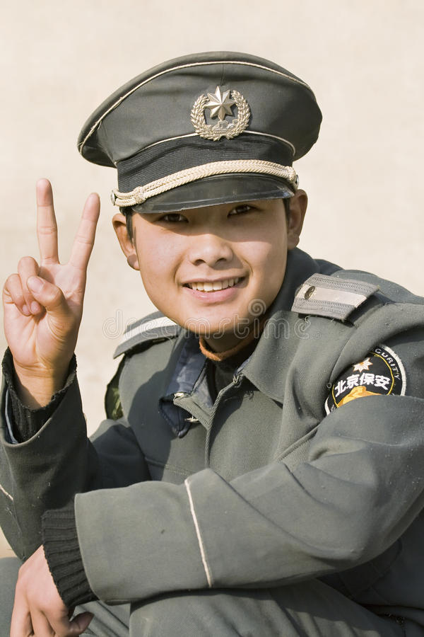 Cheerful young safety officer, Beijing, China royalty free stock photos