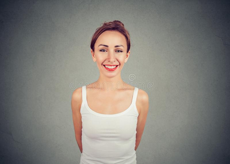 Cheerful young slim woman looking at camera royalty free stock image