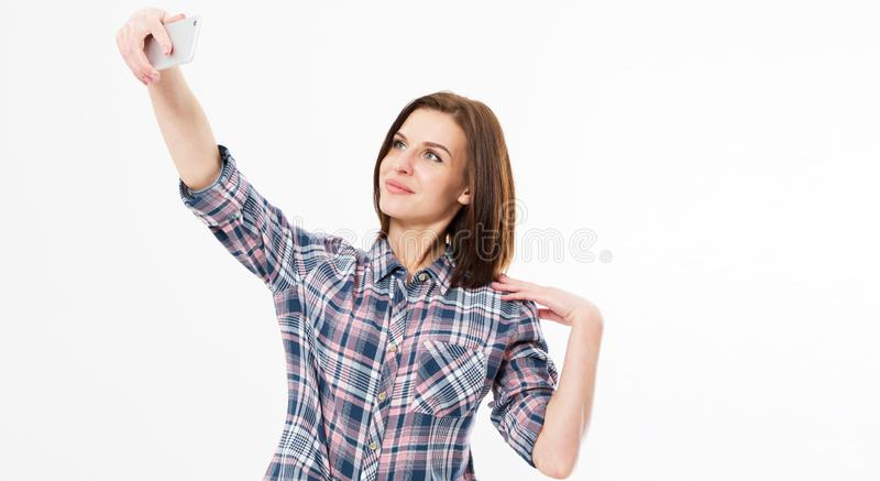 Cheerful young student girl with backpack makes selfie on her mobile phone, Studio portrait of beautiful woman smiling and making royalty free stock photos