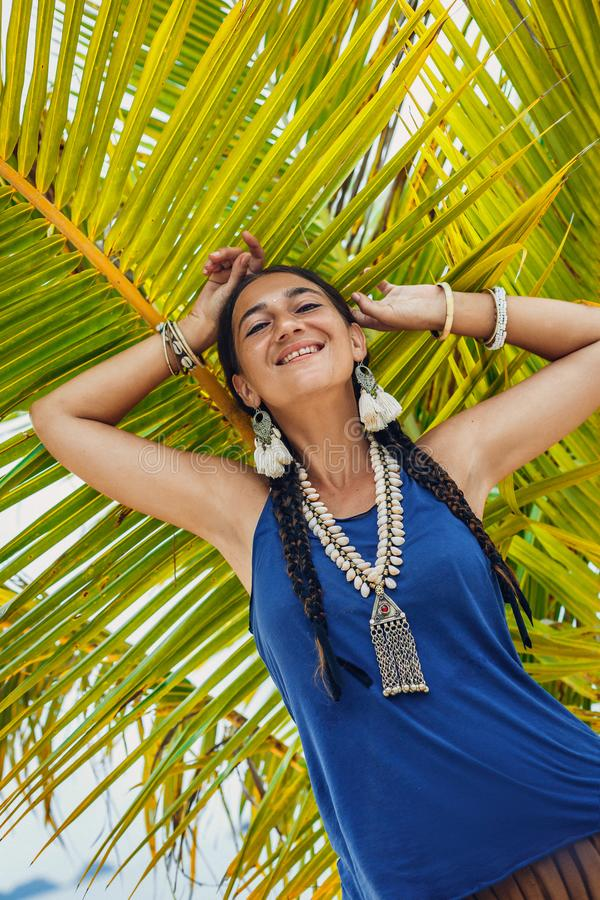 Cheerful young stylish woman having fun on the beach stock images