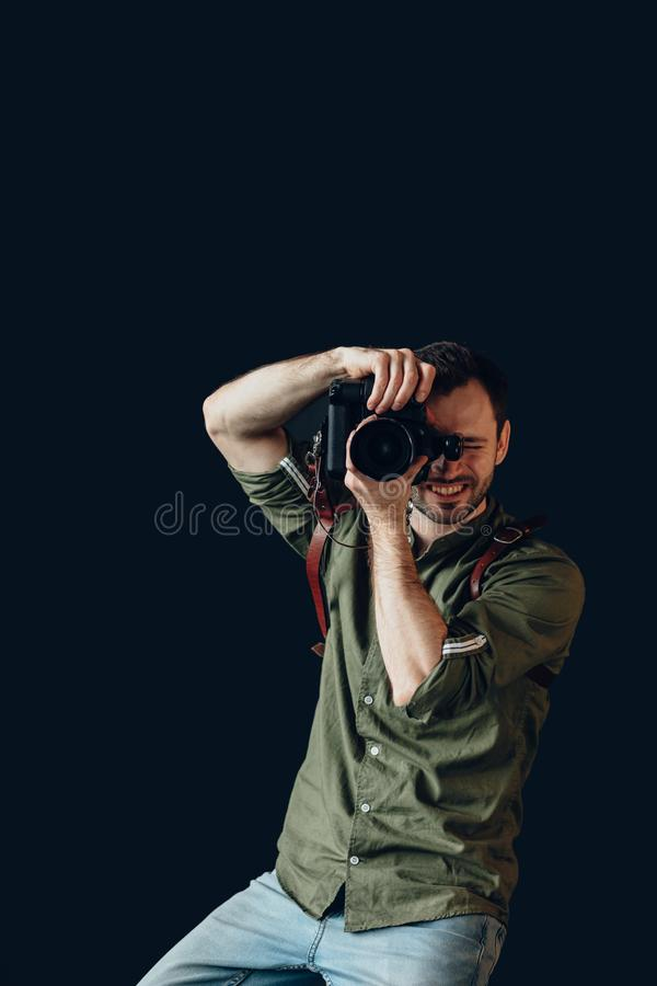 Cheerful young talented photographer working at the studio royalty free stock photography