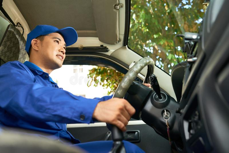 Delivery man enjoying driving royalty free stock image