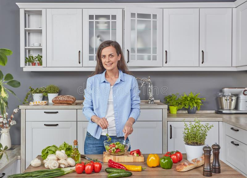 Young mom preparing meal stock photo