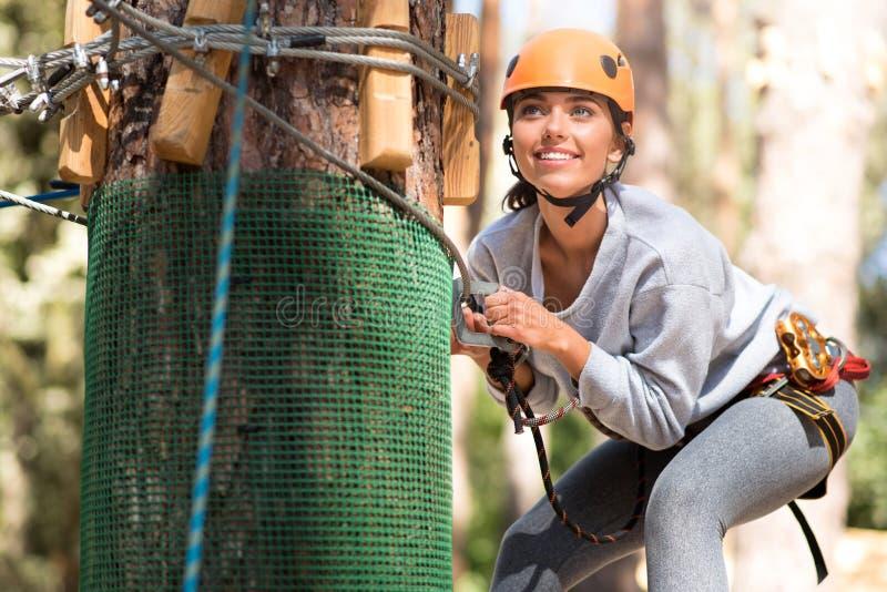 Cheerful young woman enjoying extreme activities stock image