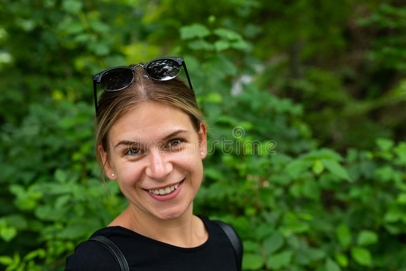 Cheerful young woman, grren background stock photo