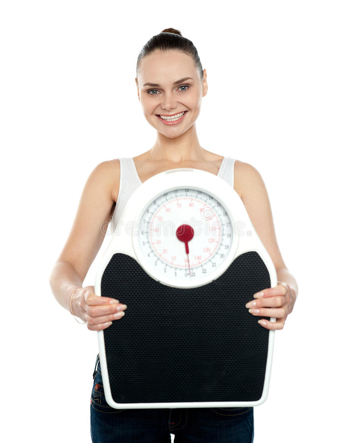 Download Cheerful Young Woman Holding A Weighing Stock Image - Image: 26097919