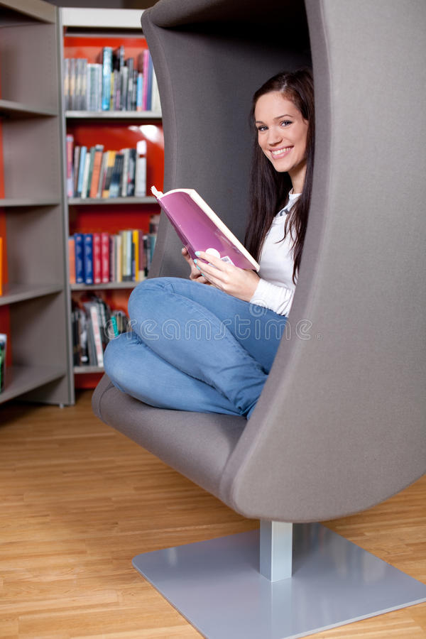 Download Cheerful Young Woman Reading Royalty Free Stock Image - Image: 22839676