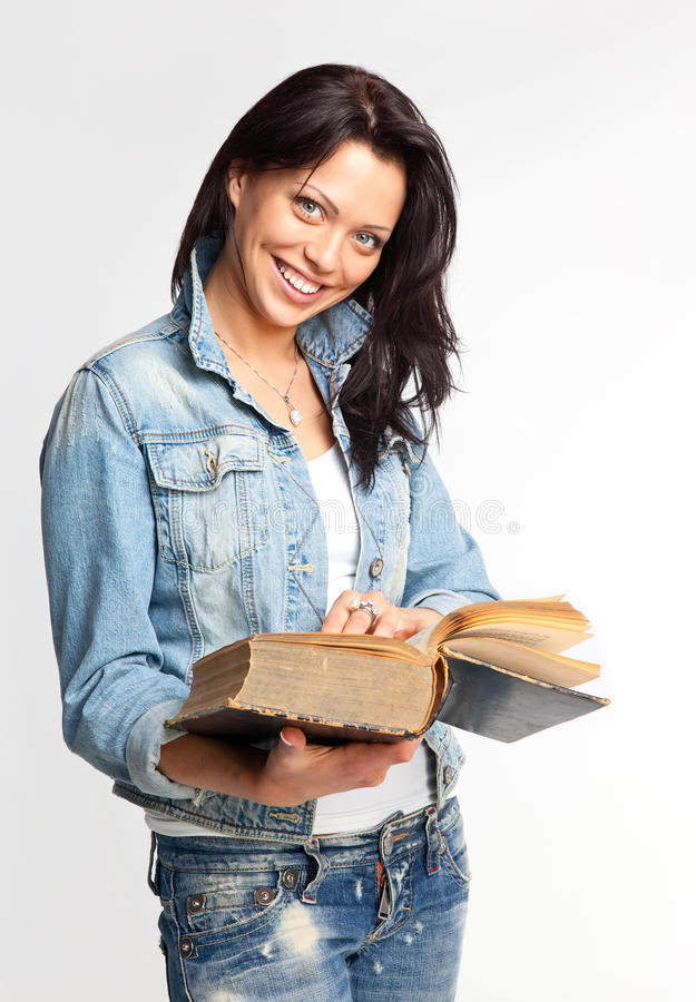 Cheerful young woman reading a book royalty free stock photo
