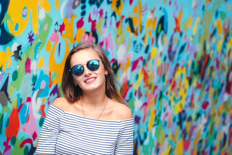 Cheerful young woman with round glasses stock photos