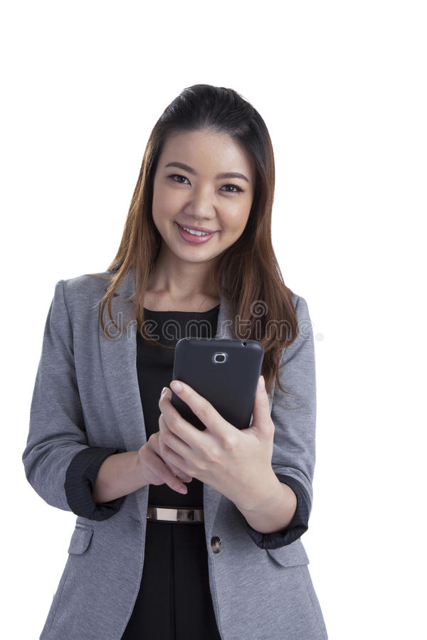 Cheerful young woman smiling at cell phone message stock photo