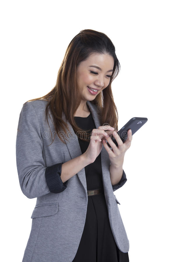 Cheerful young woman smiling at cell phone message royalty free stock images