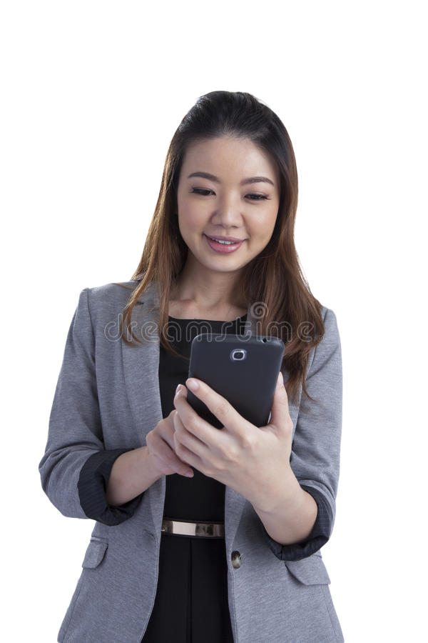 Cheerful young woman smiling at cell phone message stock photography
