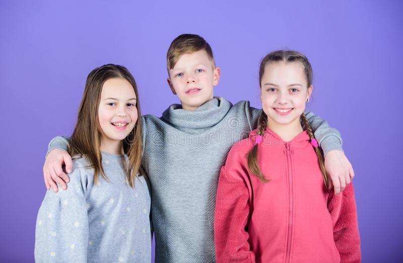 Cheerful youth. Relations and friendship. Happy to have such good friends. Teens friends. Girl and boy true friendship. Children smiling faces on violet royalty free stock photo